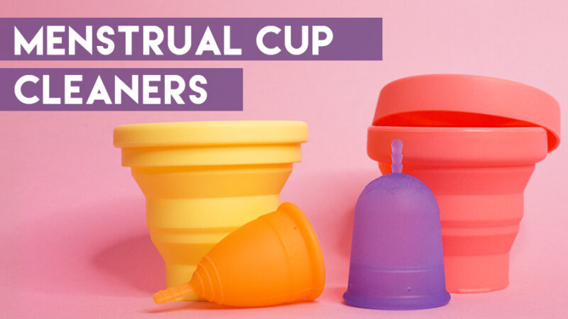 Image of two menstrual cup cleaning cups (yellow and pink) and two menstrual cups (orange an purple) on a pink background with text that reads Menstrual Cup Cleaners